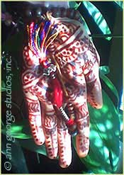 deep red color finished henna tattoo on palm